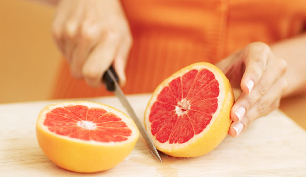 woman-cutting-grapefruit-628x363